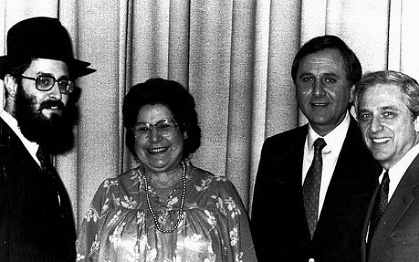 Rutgers Chabad executive director Rabbi Yosef Carlebach, left, greets, from left, Pauline Chadowitz, Jeffries Shein, and then-Rutgers president Dr. Edward Bloustein in 1980. (Photo courtesy Rutgers Chabad)